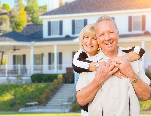 Happy couple enjoying the benefits of a Termite-free Home | SWFL Termite Inspections Cox Pest Control Management